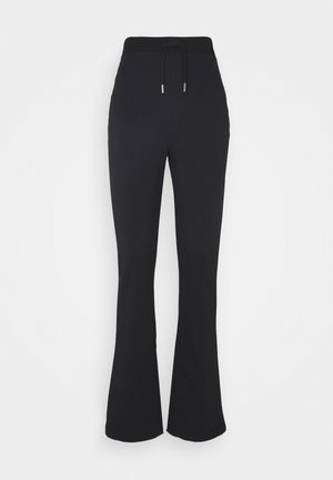 FLIRTY PANTS - Tracksuit bottoms - black