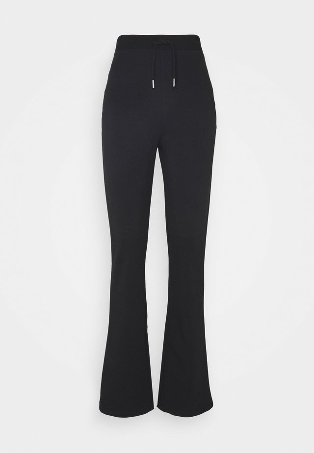 FLIRTY PANTS - Trainingsbroek - black