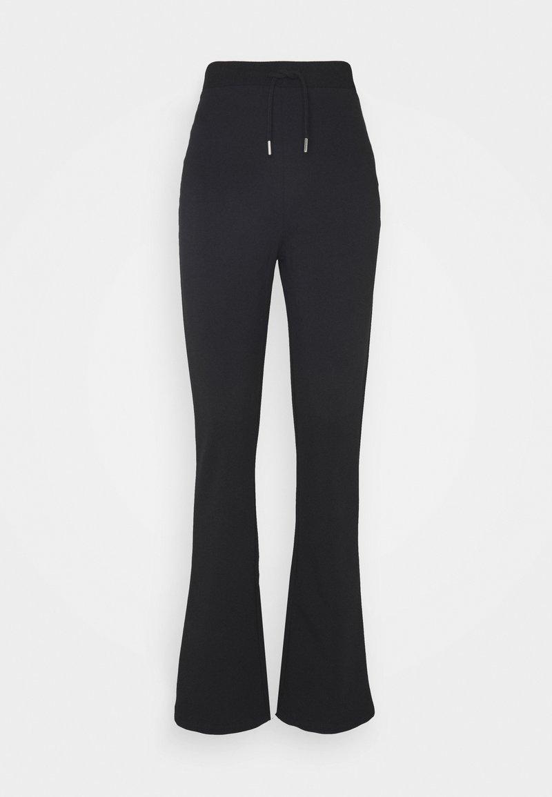 Nly by Nelly - FLIRTY PANTS - Pantalones deportivos - black