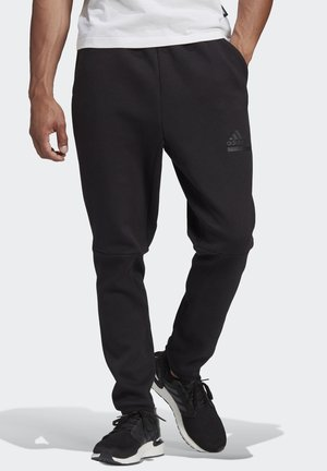 Z.N.E. SPORTSWEAR PRIMEGREEN PANTS - Tracksuit bottoms - black