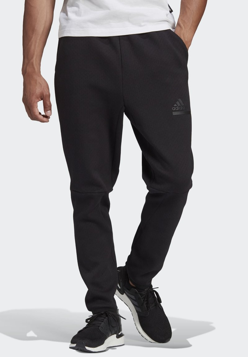 adidas Performance - Z.N.E. SPORTSWEAR PRIMEGREEN PANTS - Tracksuit bottoms - black