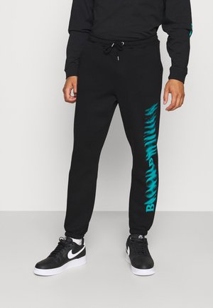 LEG PRINT - Tracksuit bottoms - black