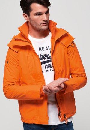 Korte jassen - orange