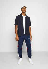 adidas Originals - TRACKPANT - Tracksuit bottoms - navy/grey/red - 1