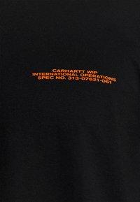 Carhartt WIP - INTERNATIONAL OPERATIONS  - Long sleeved top - black/orange - 5