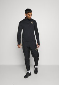 Nike Performance - PACER  - Sports shirt - black/silver - 1