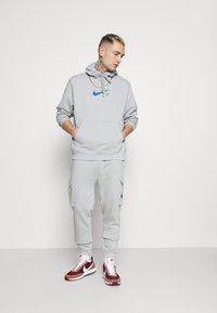 Nike Sportswear - HOODIE AIR  - Hoodie - light smoke grey - 1