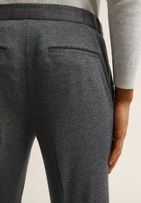 Bläck - ADAMS  - Tracksuit bottoms - dark grey mel - 2