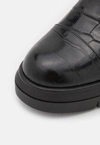 Stuart Weitzman - NISHA - Platform ankle boots - black - 5