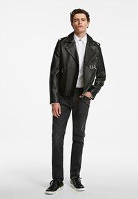 KARL LAGERFELD - Slim fit jeans - black - 1