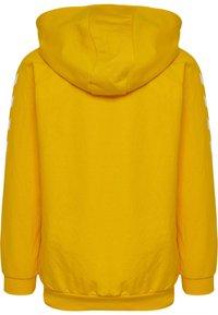 Hummel - HMLGO - Sweat à capuche zippé - sports yellow - 1