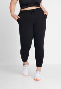 ONLY Play - ONPELINA PANTS CURVY  - Tracksuit bottoms - black - 0