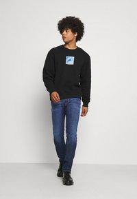 Replay - ANBASS ICE BLAST - Slim fit jeans - dark blue - 1