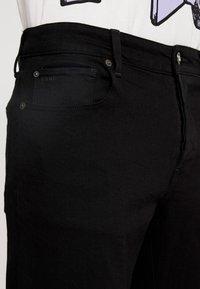 G-Star - 3301 STRAIGHT FIT - Straight leg -farkut - black denim - 4