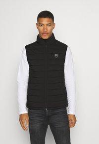 Abercrombie & Fitch - PUFFER VEST - Waistcoat - black - 0
