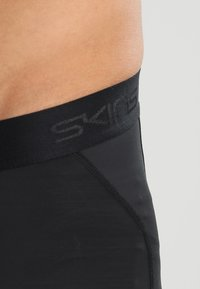 Skins - DNAMIC  - Leggings - black/citron - 5