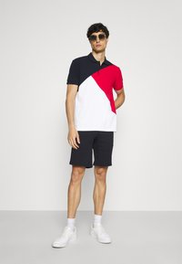 Tommy Hilfiger - DIAGONAL COLORBLOCK REGULAR - Polo shirt - desert sky/white/primary red - 1