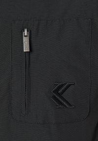 Karl Kani - SIGNATURE UTILITY JACKET - Winter jacket - black - 2