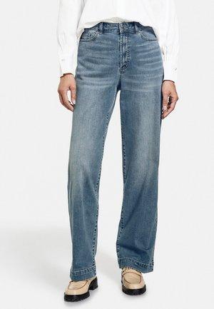 Flared Jeans - tinted blue denim
