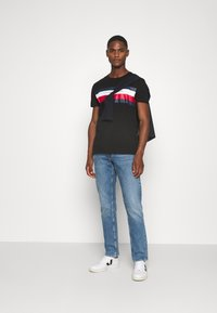 Tommy Hilfiger - STRIPE TEE - Camiseta estampada - black - 1