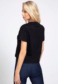 Guess - Print T-shirt - schwarz - 2
