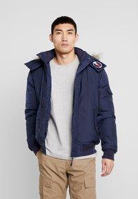 Tommy Jeans - TECH JACKET - Winter jacket - black iris - 0