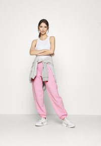 NEW girl ORDER - EMBROIDERED TEXT JOGGERS - Tracksuit bottoms - pink - 1