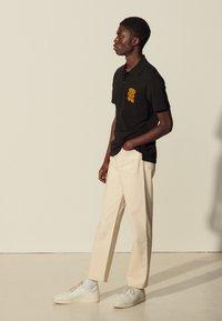 sandro - TEDDY - Polo shirt - noir - 1