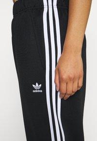 adidas Originals - BF ADICOLOR PRIMEBLUE RELAXED PANTS - Tracksuit bottoms - black - 6