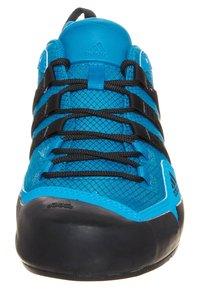 adidas Performance - TERREX SWIFT SOLO HIKING SHOES - Hiking shoes - dark solar blue/black - 3