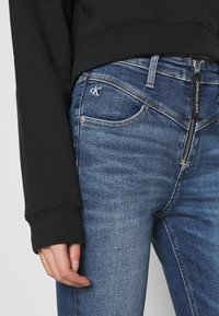 Calvin Klein Jeans - HIGH RISE  - Jeans Skinny Fit - mid blue - 4