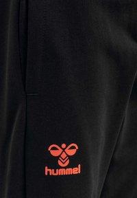 Hummel - Tracksuit bottoms - black fiesta - 3
