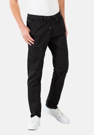 REFLEX EASY ST - Trousers - black