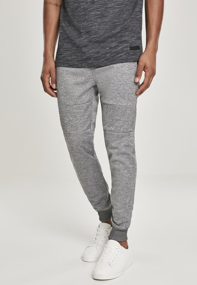 HERREN ZIPPER POCKET MARLED TECH FLEECE JOGGER - Pantalon de survêtement - marled black