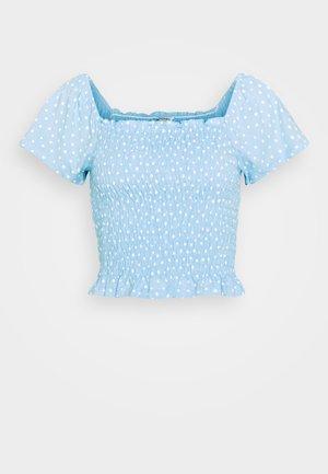 RIVA  - T-shirt print - blue irrydot