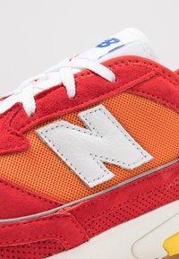 New Balance - MSXRC - Trainers - red/yellow - 8