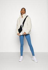 Nike Sportswear - Winter jacket - fossil/black - 1