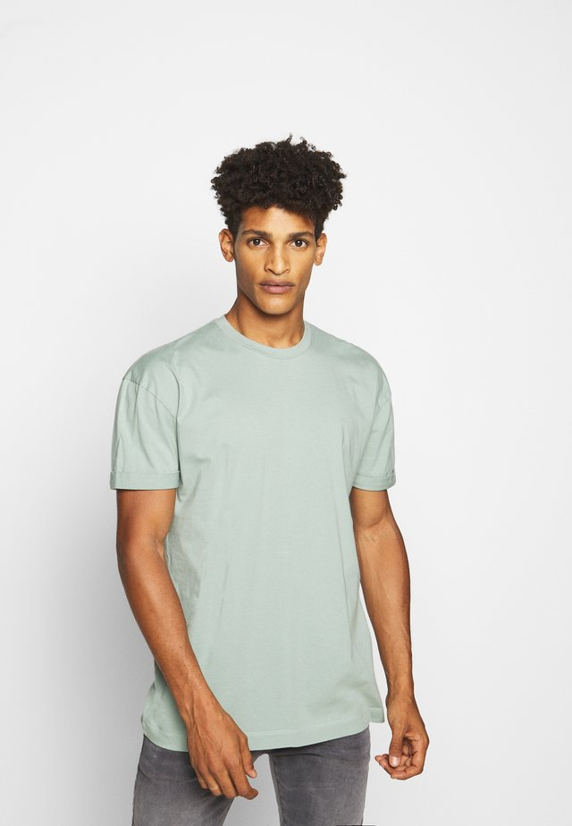 THILO - Basic T-shirt - grün