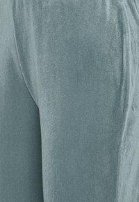 Vila - VIVELVETTA FLARED PANT - Tracksuit bottoms - goblin blue - 2