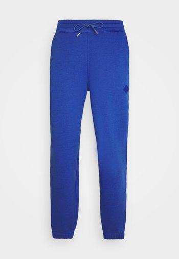 HANGER TROUSERS - Teplákové kalhoty - blue