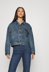 Levi's® - NEW HERITAGE TRUCKER - Denim jacket - blue denim - 0