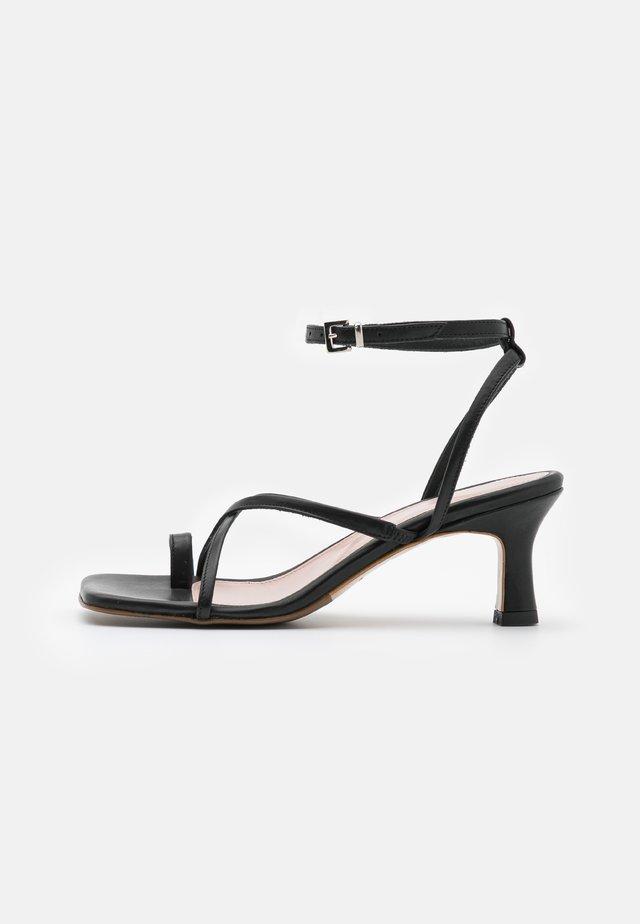 COMODARIA - Sandales - black