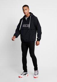 Nike Sportswear - Windbreaker - black - 1