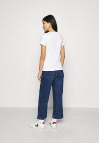 Tommy Hilfiger - SLIM ROUND NECK - T-shirts - white - 2