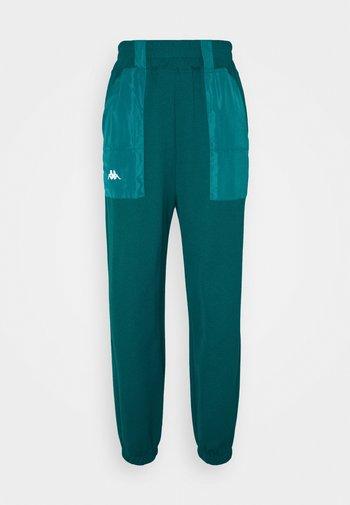 IVYNALA - Pantalones deportivos - shaded spruce