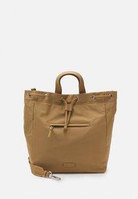 ARINA - Tote bag - soaked sand