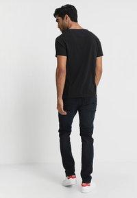 Tommy Jeans - ORIGINAL REGULAR FIT - T-shirt basic - black - 2