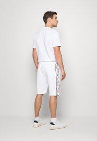 Calvin Klein - PRIDE  - Pantalon de survêtement - white - 2