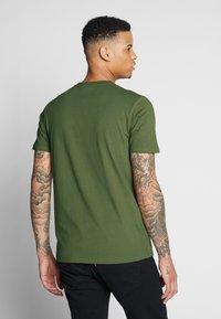 Ellesse - SALINE - Printtipaita - dark green - 2