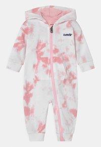 Levi's® - ZIPHOODIECOVERALL - Haalari - light pink - 0